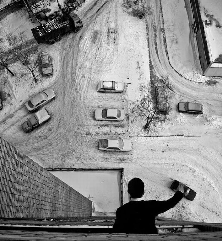 Man playing with cars