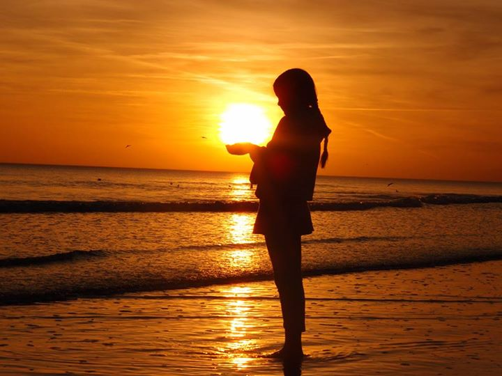 sunset held by girl