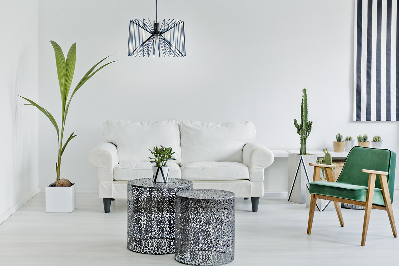 living room containing white and green furniture for spring