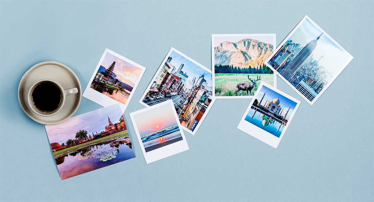 polaroid style photographs on a table with travel images