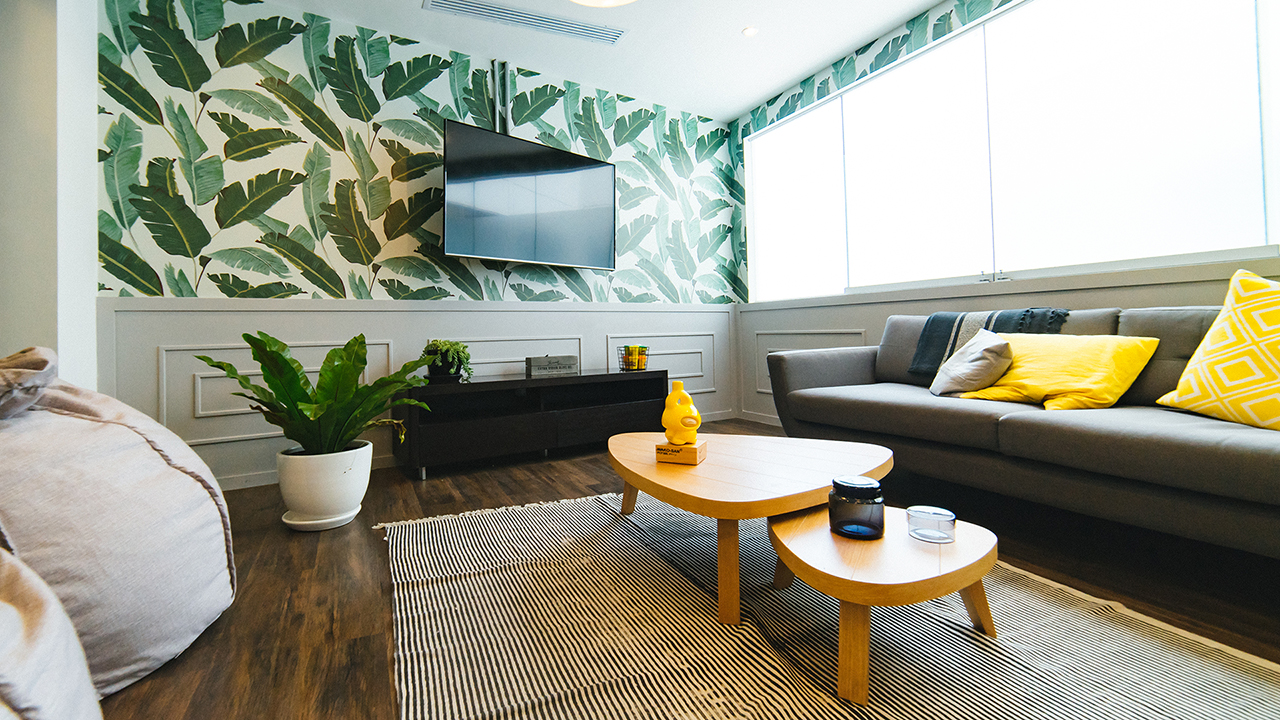living room with jungle print wall paper
