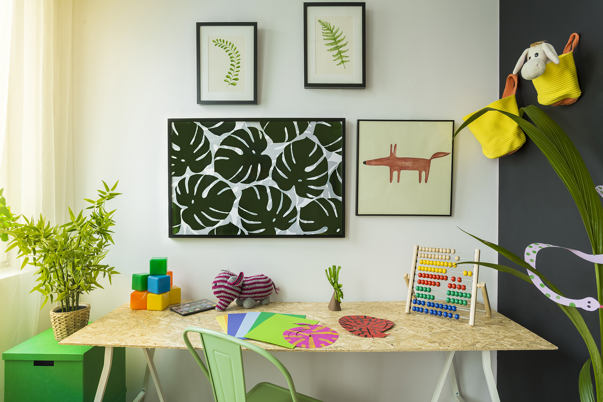 Creative style child study room with desk and green chair