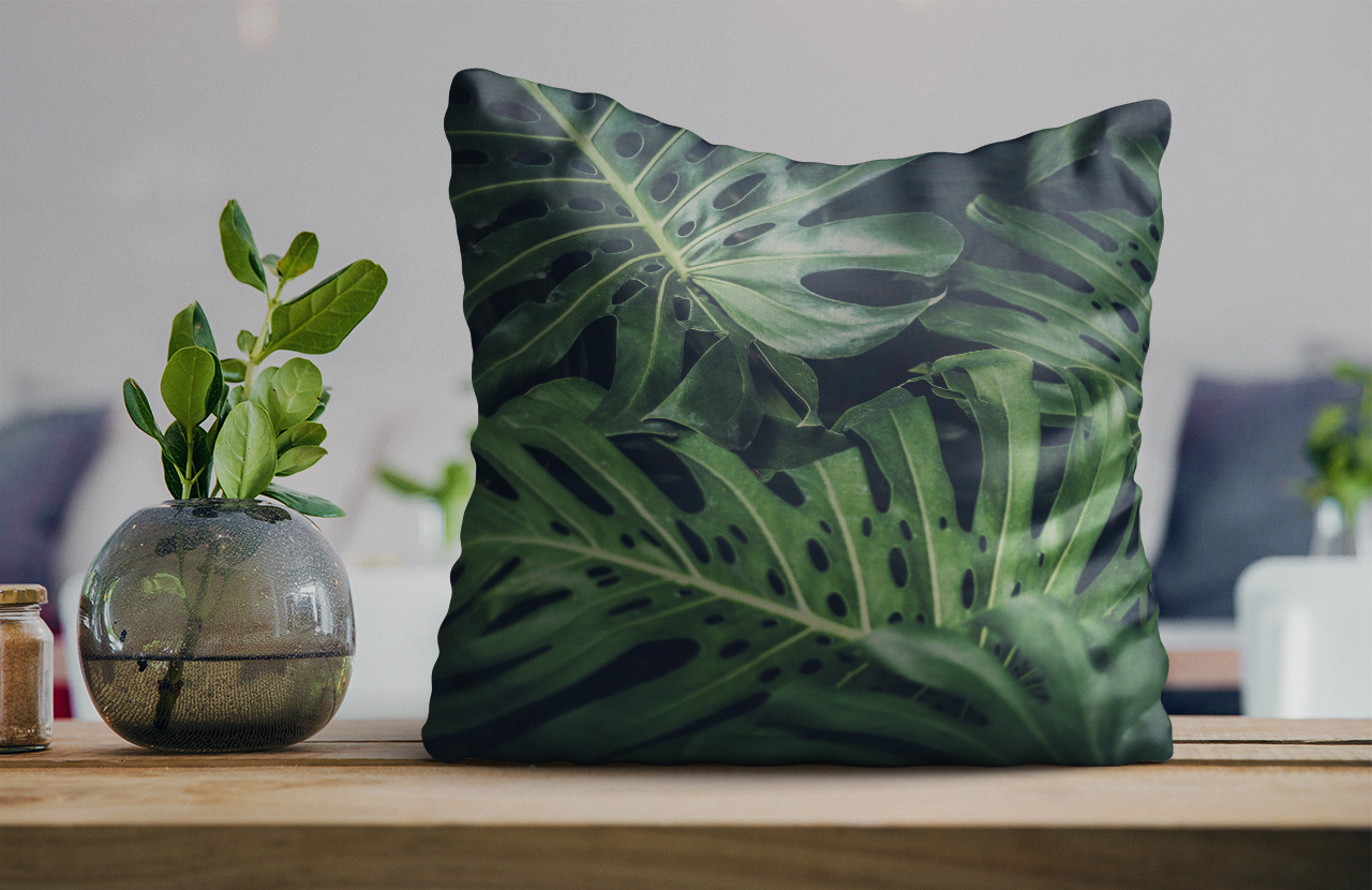 cushion with jungle leaf pattern