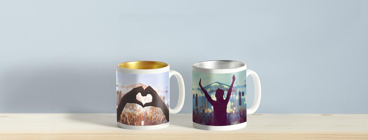 one silver mug, one gold mug with concert photos